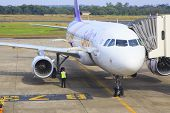 Ubonratchathani Thailand-november21 : Thai Airways Plane Parking On Ubonratchathani Airport And Chec