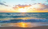 stock photo of horizon  - Spring sunrise at the empty beach in Miami Beach, Florida.