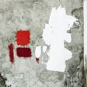 Concrete wall with abstract painting