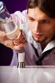 Young Man Bartender Preparing Alcohol Drink