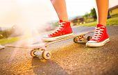 Female feet on skateboard
