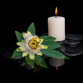 Spa Concept Of Passiflora Flower, Green Leaf With Drop And Candle On Zen Stones In Reflection Water,