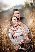Pregnant couple in autumn