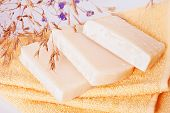 Homemade natural soaps on terry towels