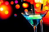 Blue Cocktail With Light Disco Bokeh Background With Space For Text