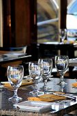 Four glasses on dining table of restaurant