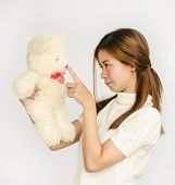 Asian Teen Holding A  Bear Doll.