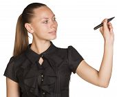 Young successful business woman writing with pen