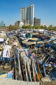 MUMBAI - 12 DECEMBER 2012: People at Dhobi Ghat, the world's largest outdoor laundry on December 12,