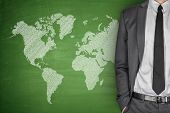picture of cartographer  - World Map on green Blackboard with businessman - JPG