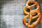stock photo of pretzels  - pretzels on a dark wood background - JPG