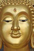 Buda nueva cara latón