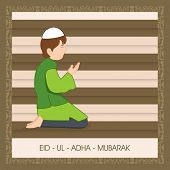 Muslim boy praying (Namaz, islamic prayer) on stylish abstract background for Muslim community festival Eid-Ul-Adha Mubarak.