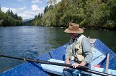 pic of mckenzie  - A fisherman looks down the Mckenzie River from his drift boat near Eugene Oregon - JPG