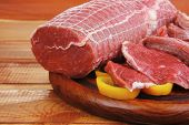 fresh raw meat prepared for cooking on wood