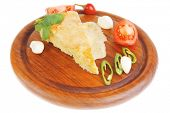 dairy food : vegetable cheese casserole slice on wooden plate served prepared with tomatoes  and gar