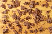 pieces of chocolate on wooden cutting board