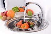 image of mixing faucet  - Washing fruits and vegetables close - JPG