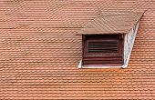 Dormer Window And Red Roof Tiles