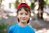 Little Boy In Cap Outdoor