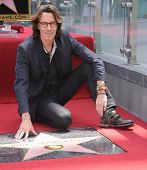 LOS ANGELES - MAY 09:  Rick Springfield arrives to the Walk of Fame Honors Rick Springfield  on May 09, 2014 in Hollywood, CA.