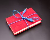 Ribbon from the usb cable on book as a present