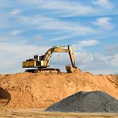 image of boom-truck  - Excavator Machine Loading Dumper Truck At Sand Quarry - JPG