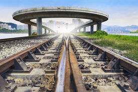 foto of land development  - railways track and bridge cross over with urban scene behind use for land and town development and infra structure construction and land transport government service - JPG