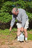 Active Senior Spraying Weeds