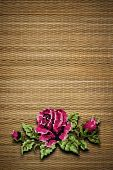 rose on a background of beige straw