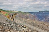 stock photo of iron ore  - General view of the iron ore opencast mining - JPG