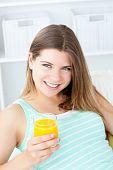 Dg_mixe9Cute woman drinking an orange jus against