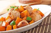 Chicken meatballs with a garnish cooked of baked pumpkin
