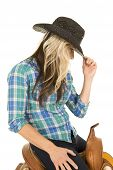 Cowgirl Sitting On A Saddle Touch Black Hat Look Down