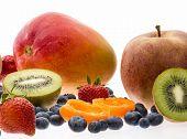 Halved Apricot And Kiwi Fruit On White Background