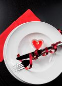 Top Of View Of Valentine Day Dinner With Table Setting In Red And Elegant Heart Ornaments