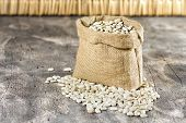 picture of phaseolus  - Sack with white beans on wooden table - JPG