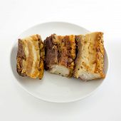 picture of pork belly  - Freshly baked crispy pork belly on white background - JPG