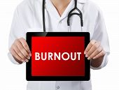 Doctor Showing Tablet With Burnout Text.