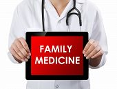 Doctor Showing Tablet With Family Medicine Text.