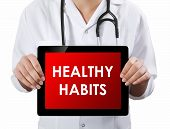 Doctor Showing Tablet With Healthy Habits Text.