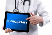 Doctor Showing Tablet With Chemotherapy Text.