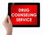 Doctor Showing Tablet With Drug Counseling Service Text.
