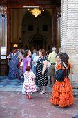 Spanish people entering a church, Marbella.