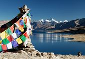 stock photo of dharma  - Tso Moriri Lake with prayer flags  - JPG