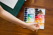 stock photo of paint palette  - Paintbrush and paint palette with artist