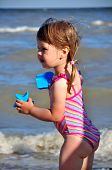 Little cute girl at the beach