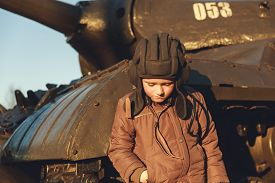 picture of panzer  - Portrait of young sad boy standing near by panzer - JPG