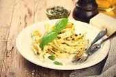 foto of pesto sauce  - Pasta tagliatelle with green pesto sauce - JPG