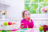 picture of little young child children girl toddler  - Child eating breakfast - JPG